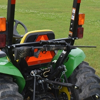 Tag Along Tool and Gun Rack for Tractors and Mowers